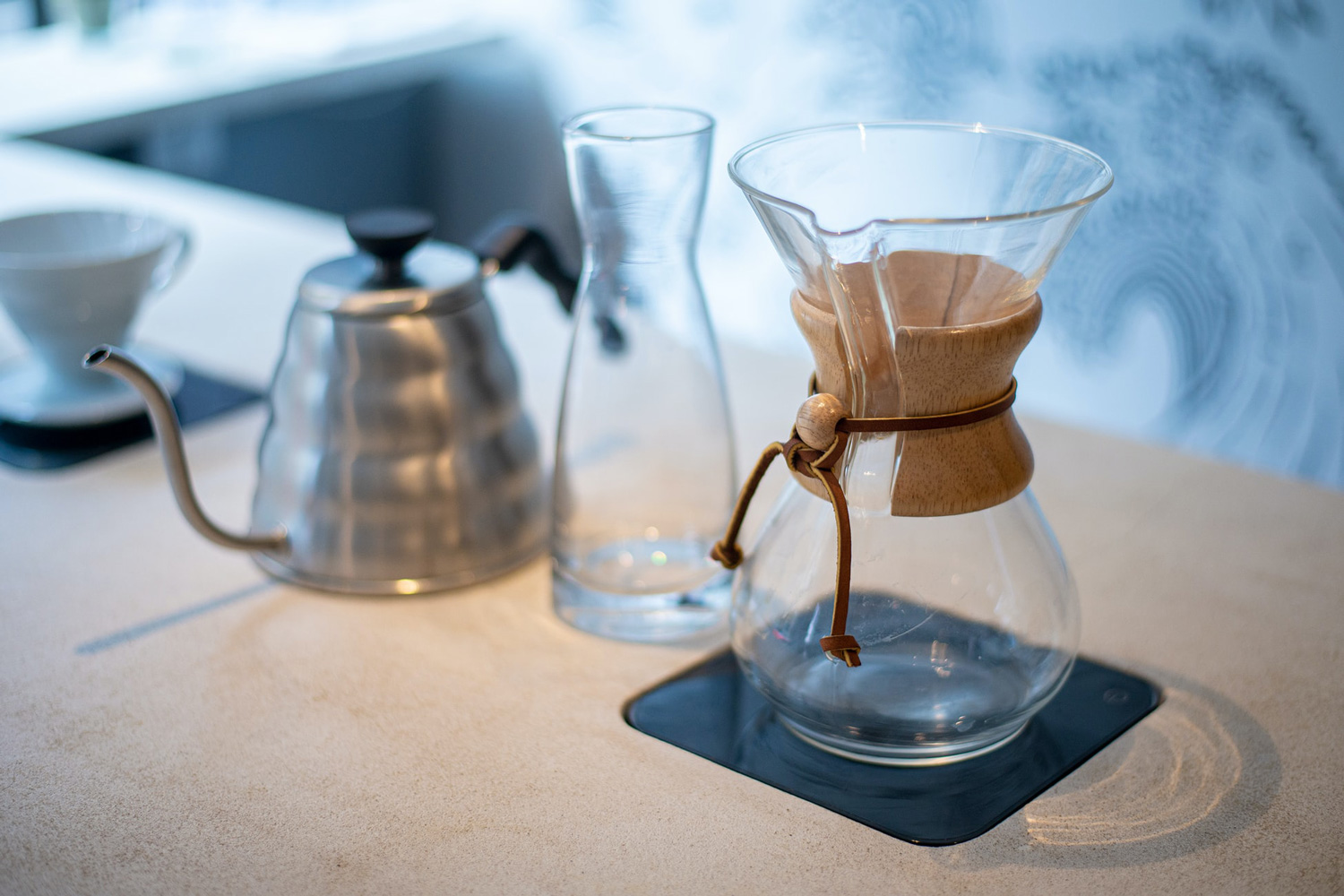 various types of coffee brewing equipment placed side by side on a table