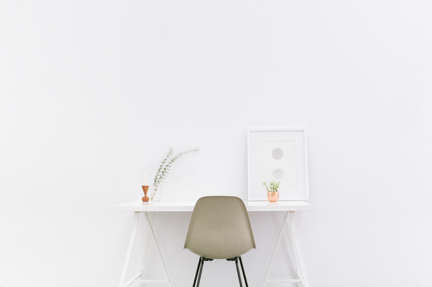 a white study desk placed against a white painted wall
