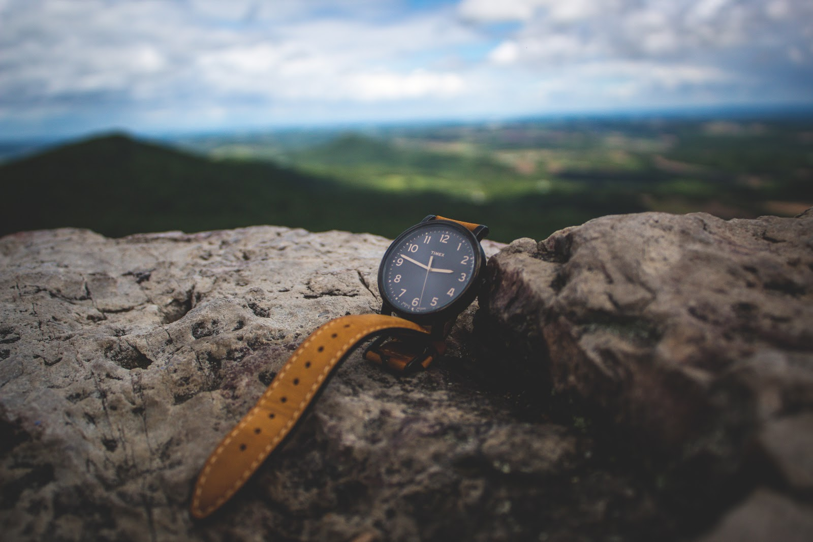 a watch placed on a rock