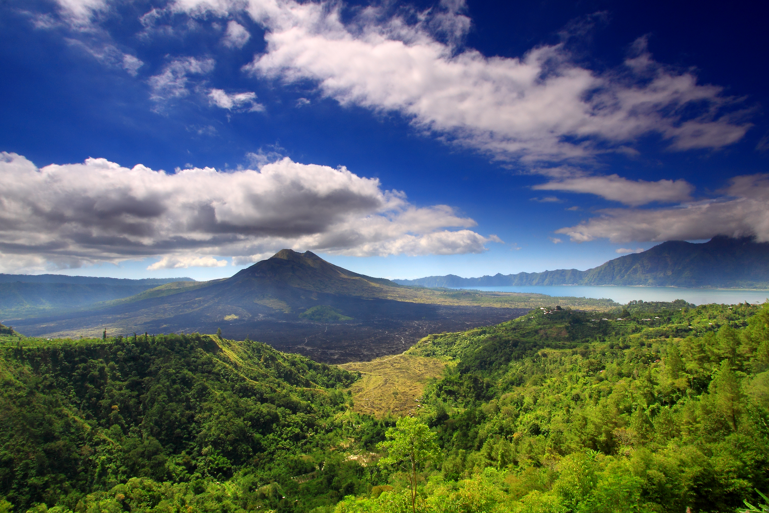 The rolling hills of Mount Batur, a volcano on the island of Bali.