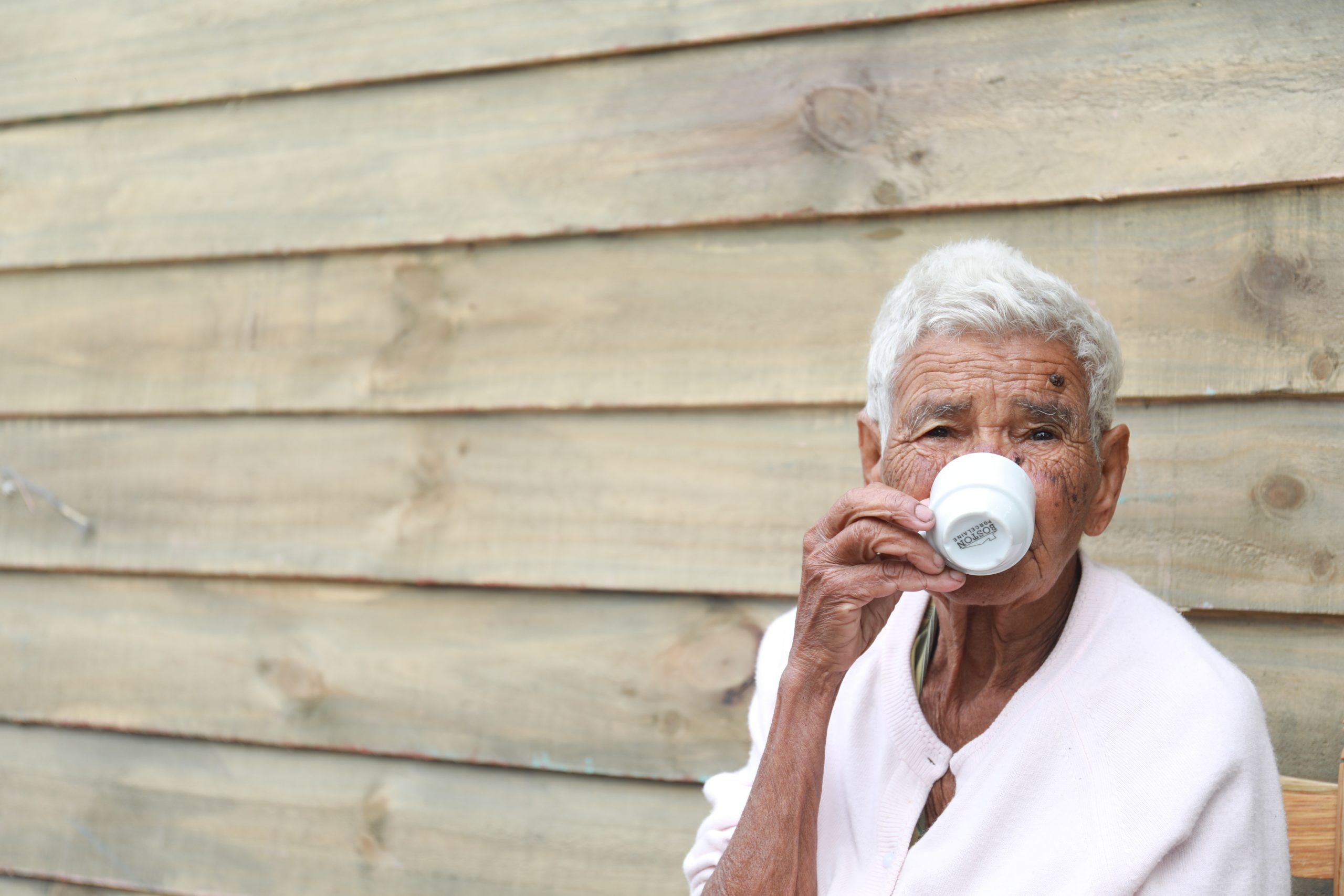 An old lady drinking coffee