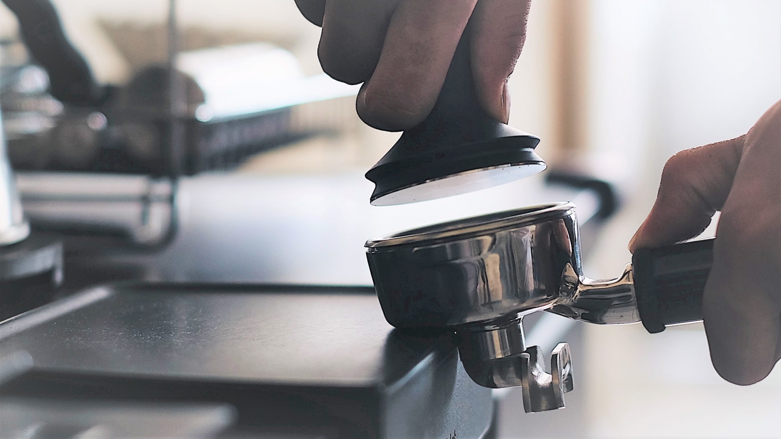 a person tampering coffee