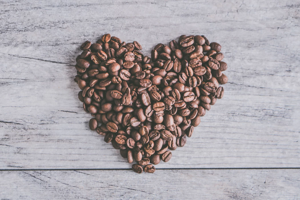 coffee beans placed together to form a heart shape