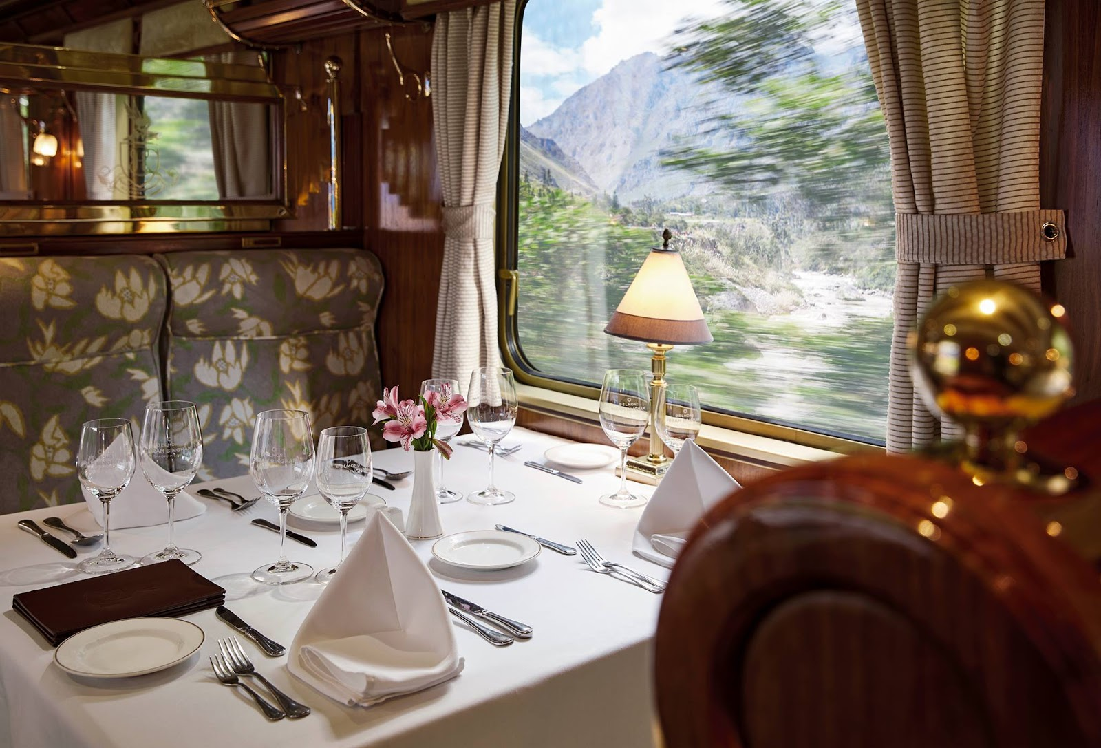a fancy dining table setup in a passenger train