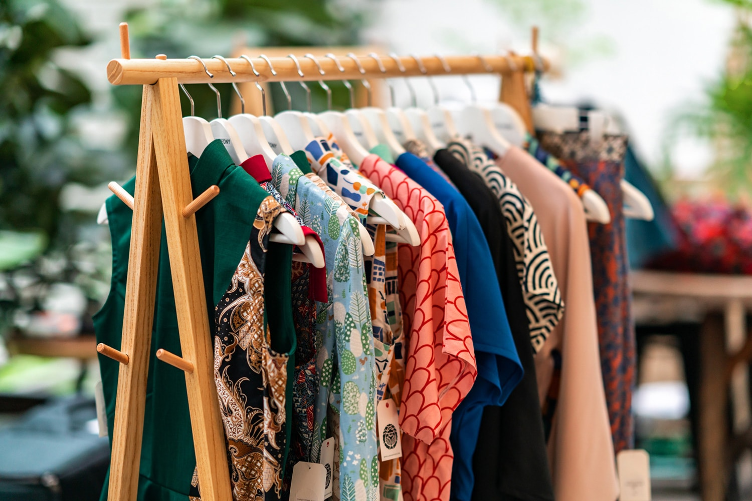 A clothes rack of cheongsams from Lack & Peony