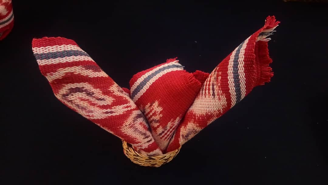 A red hand woven scarf