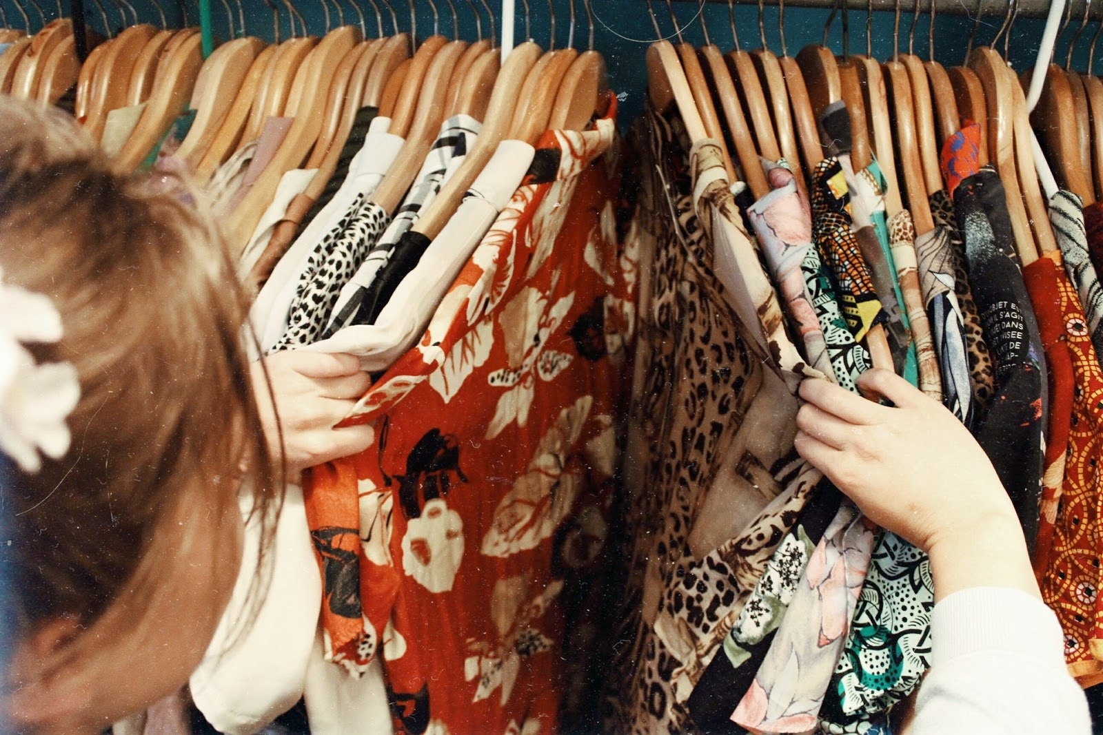 a lady browsing a clothes rack