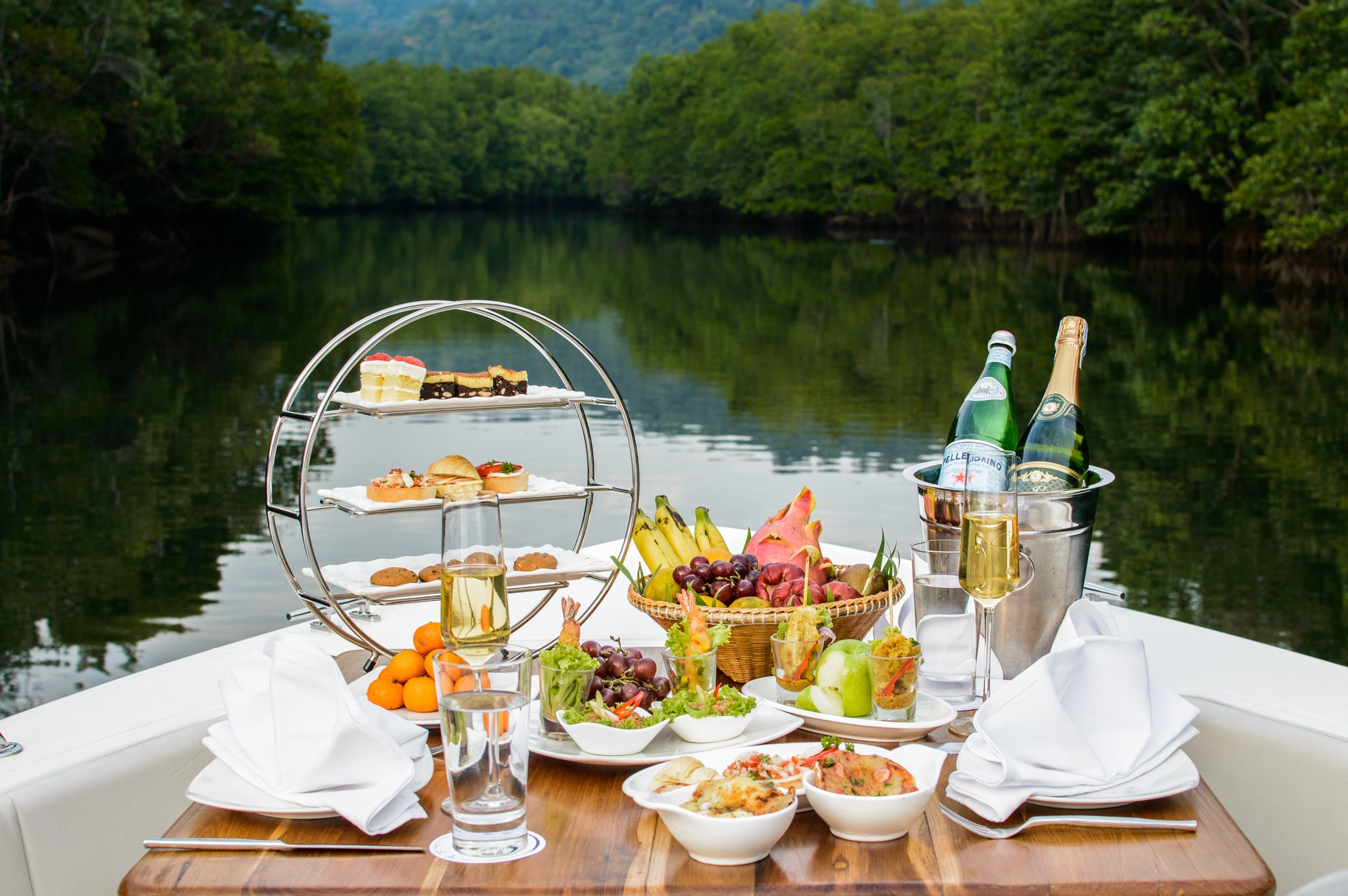 an afternoon tea set up on a boat