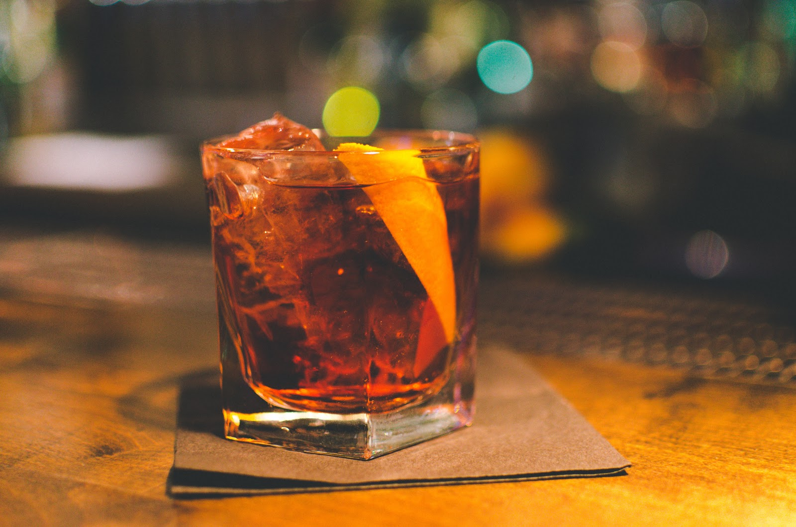 A negroni cocktail served with a slice of orange peel