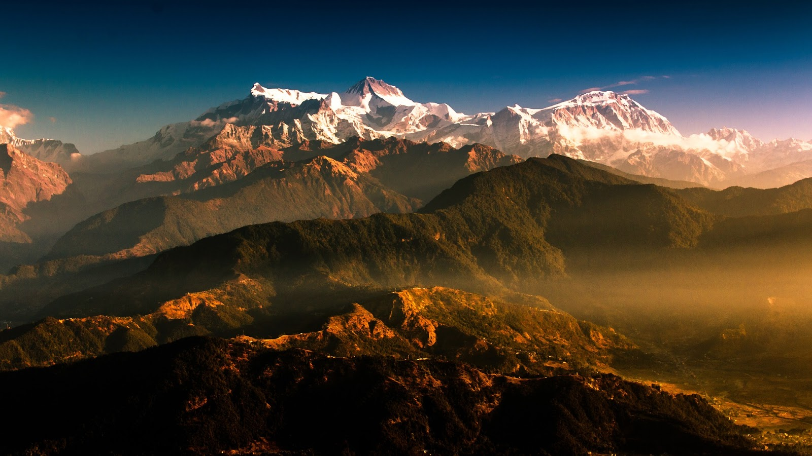 a landscape view of the Himalayas during sunset