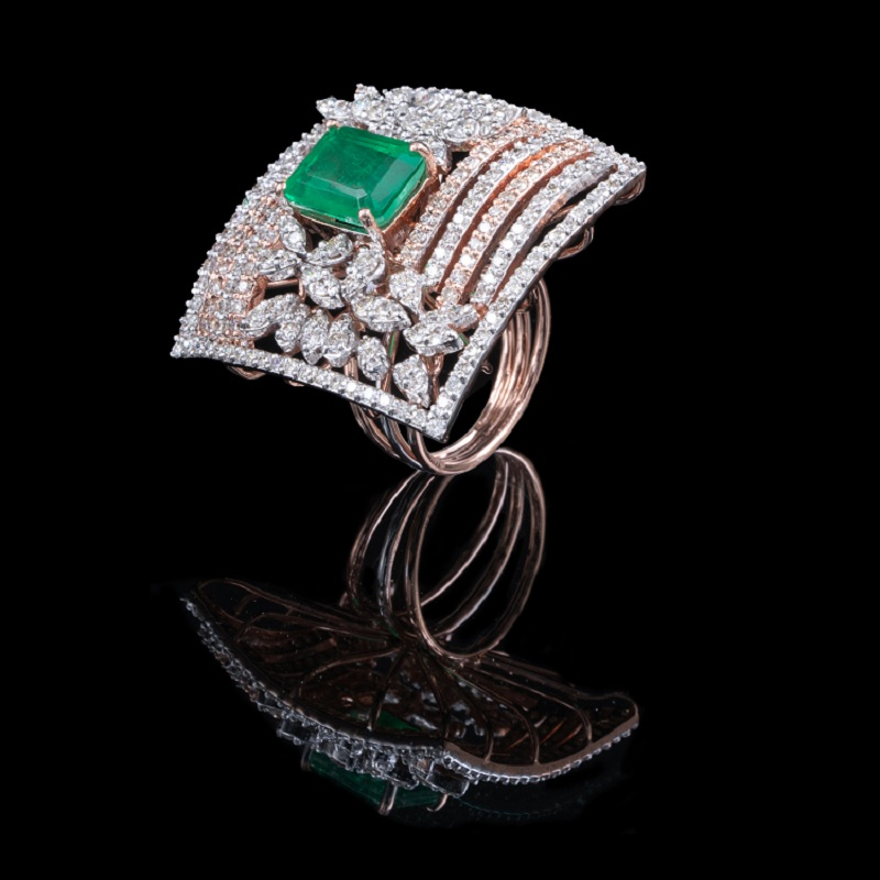 a diamond ring with an emerald jem as a centrepiece