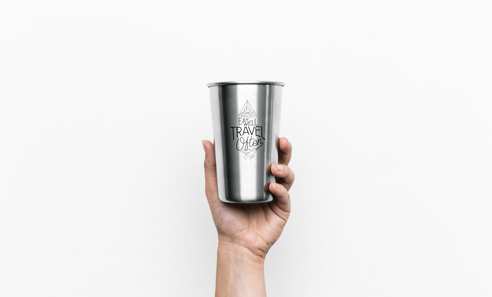 a hand model holding a stainless steel tall cup