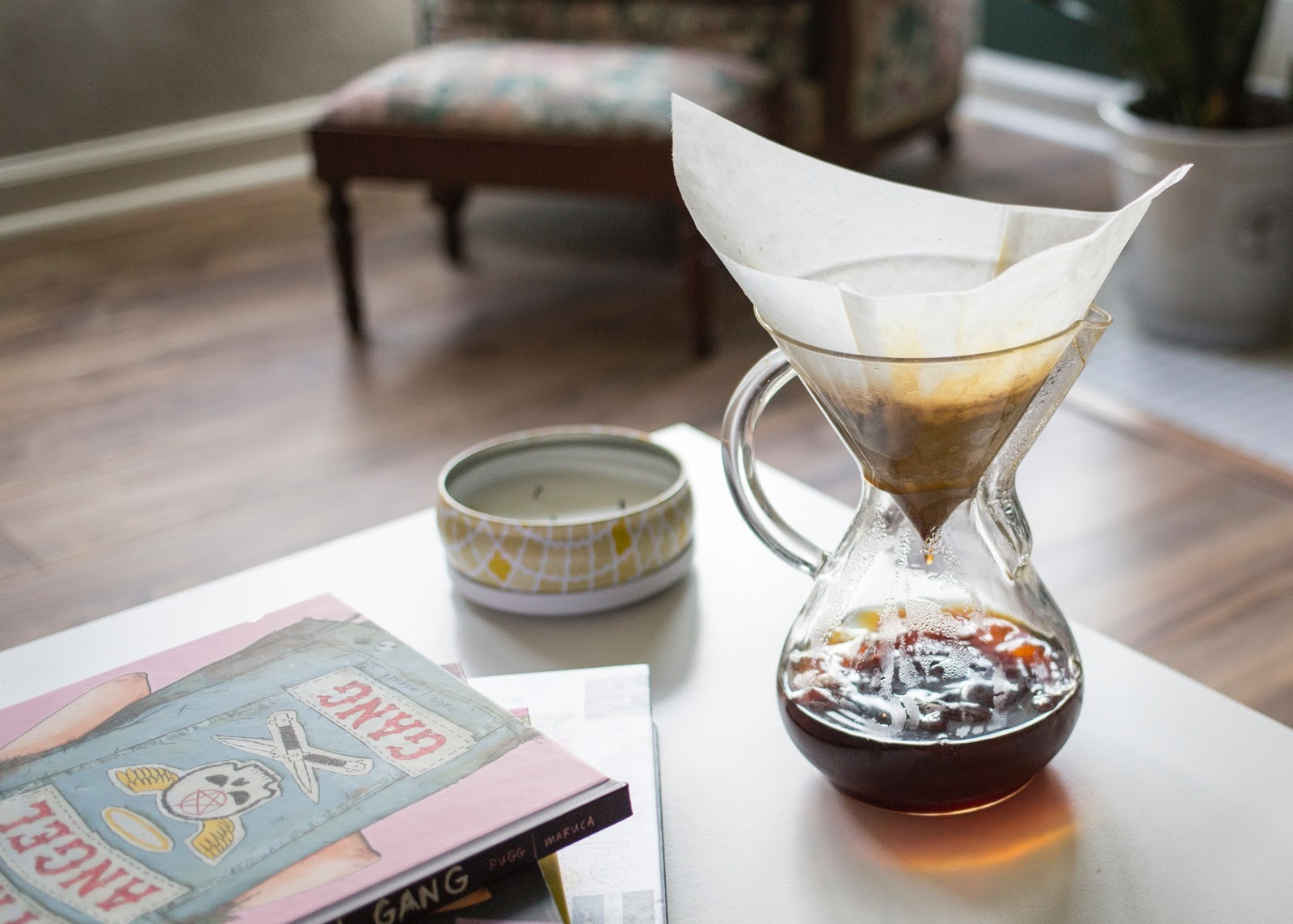 a filter drip coffee placed on a table in the living room
