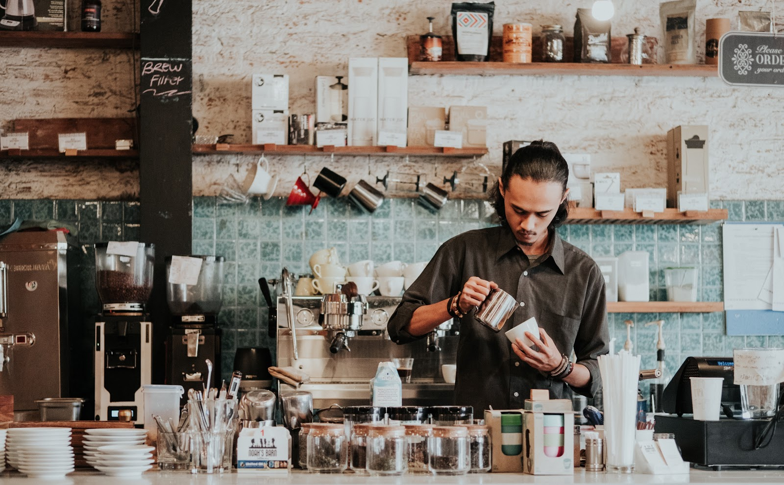 An Asian Barista making coffee