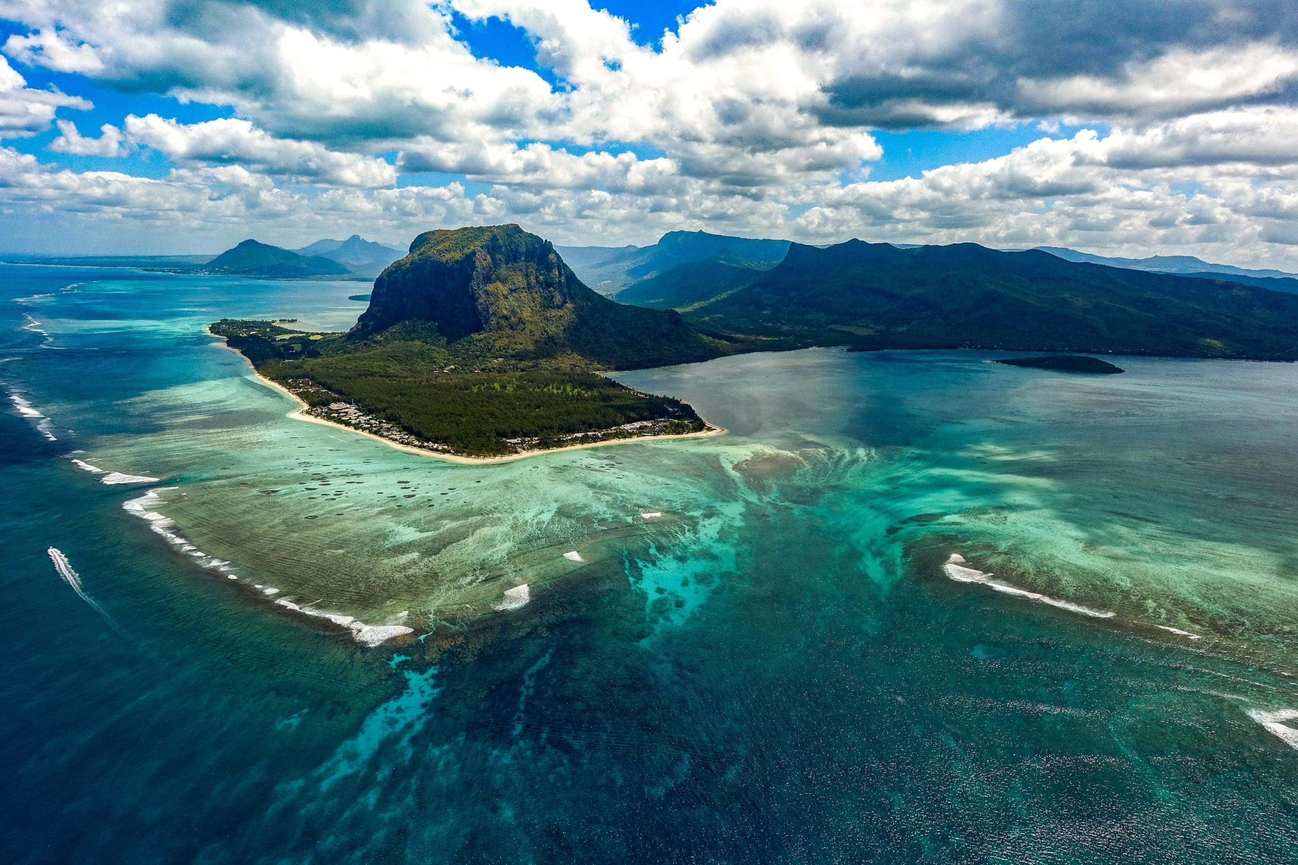 an aerial view of a underwater waterfall in Mauritius
