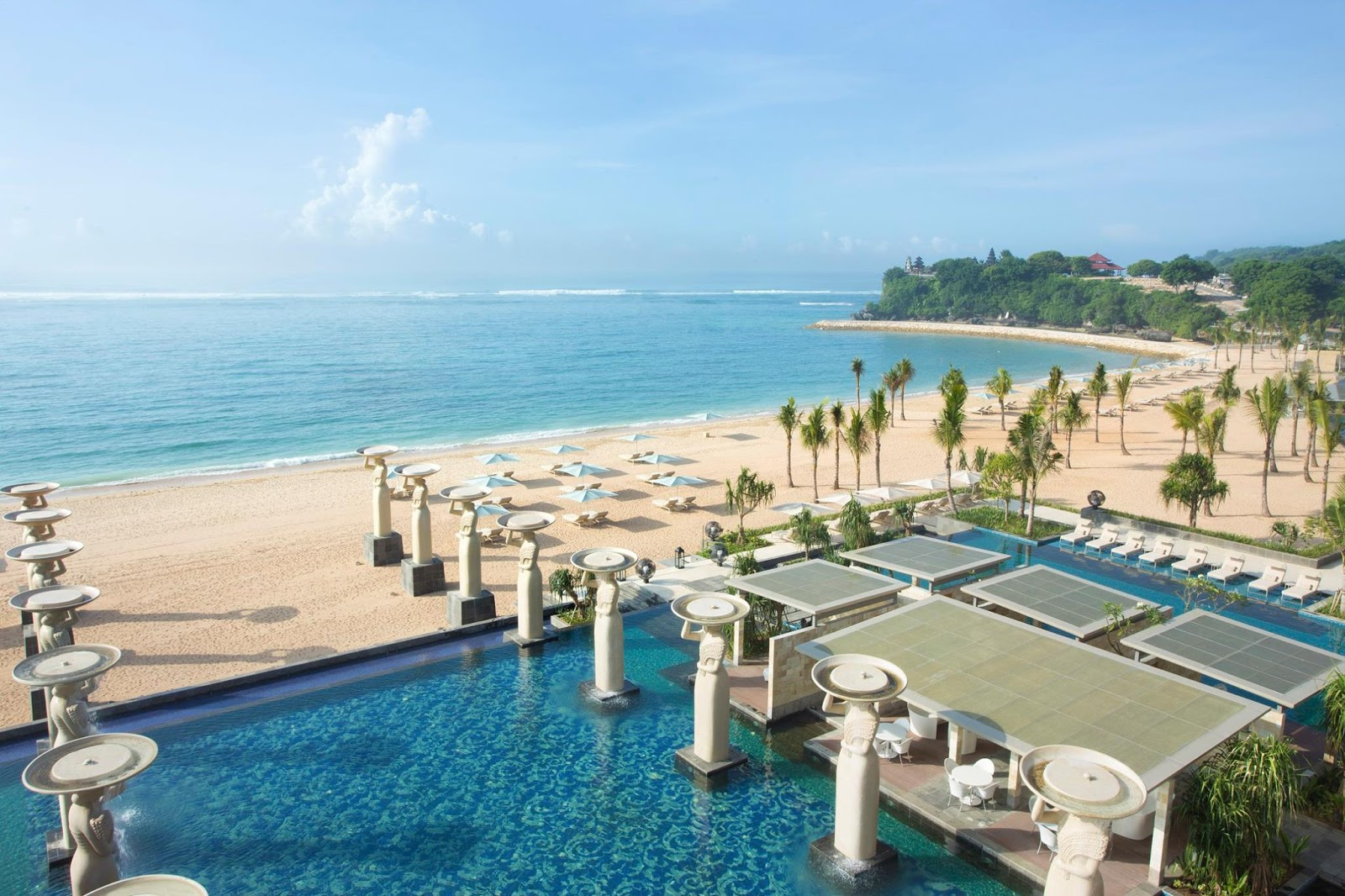 a resort's swimming pool at the beach