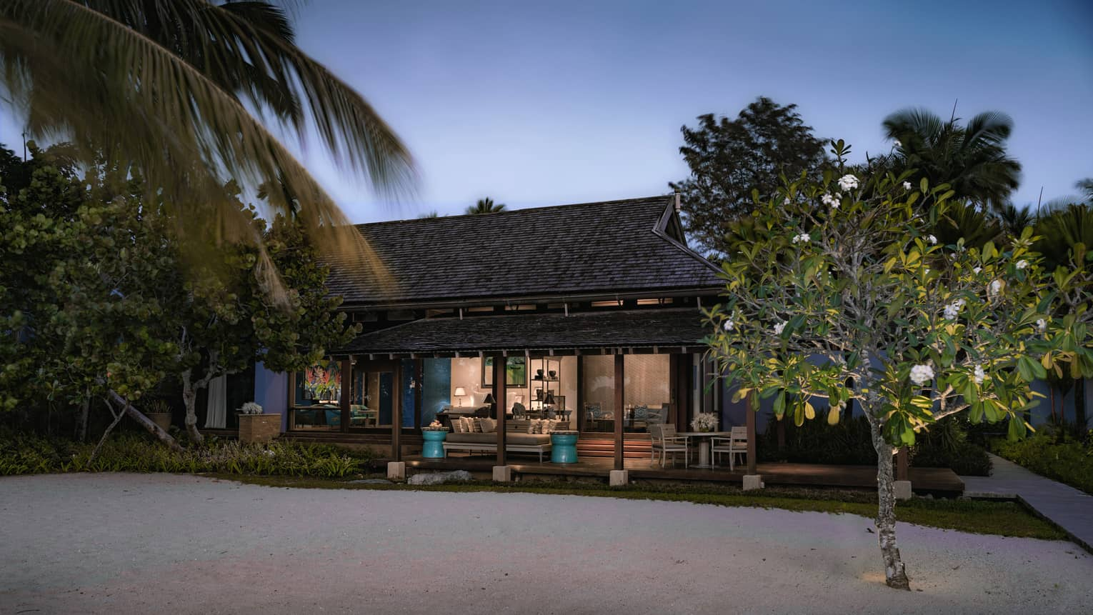 a resort bungalow surrounded by lush greenery