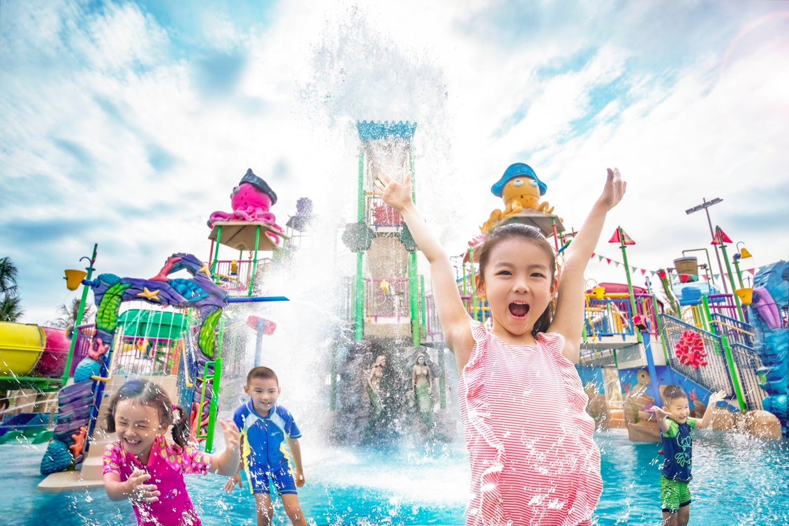 children playing at a water park