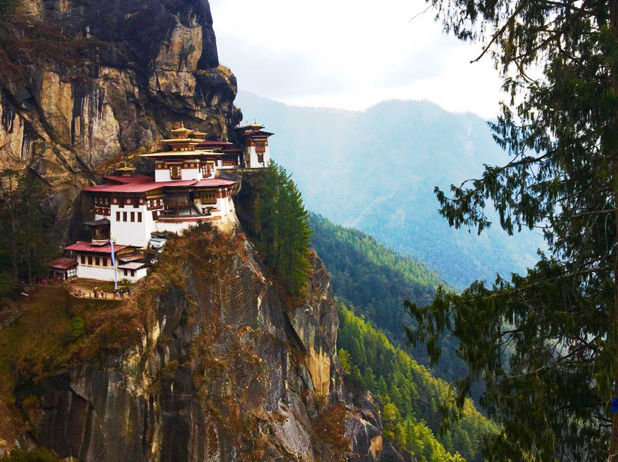 A temple perched on the edges of a mountain