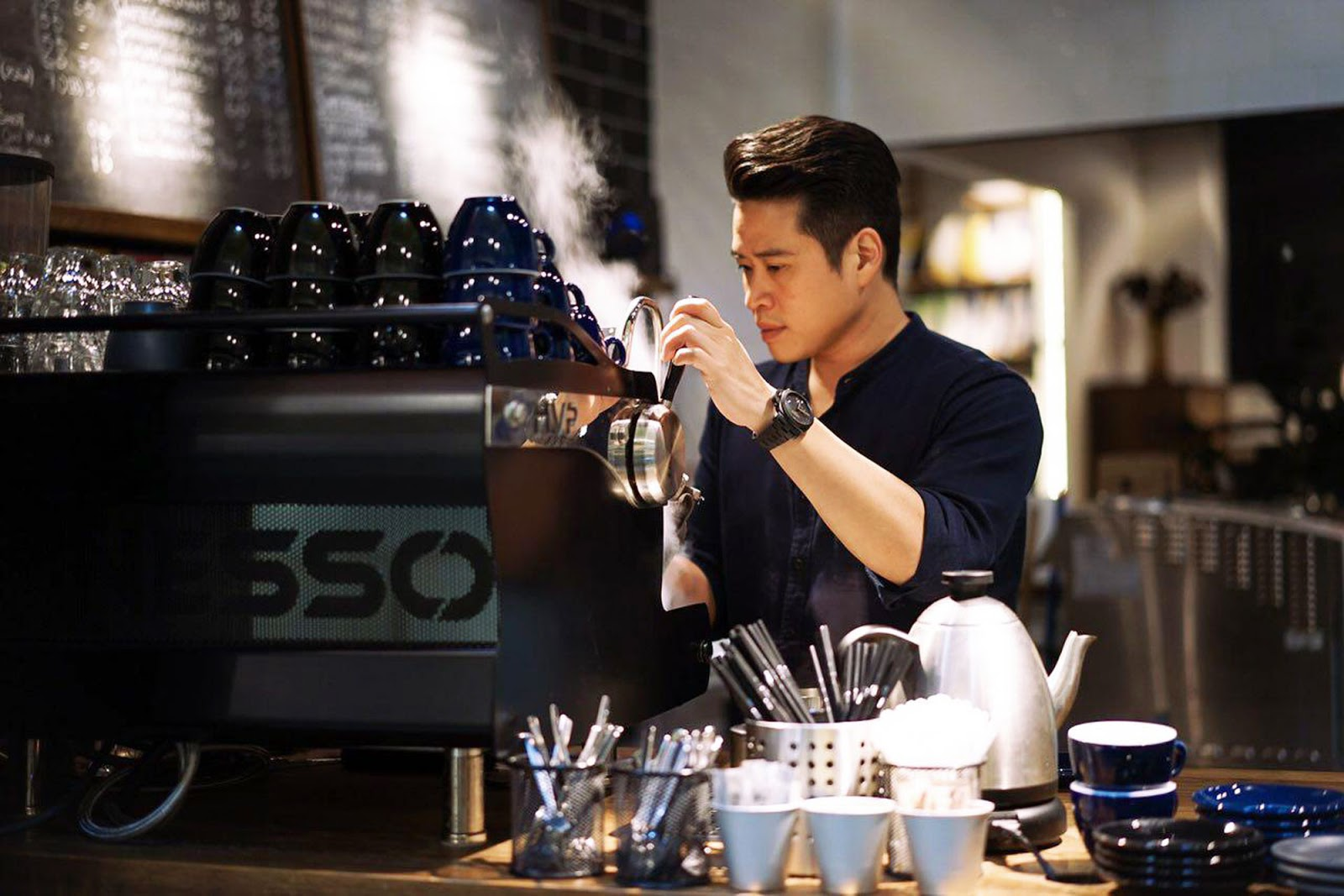Julian Koh, Brand & Design Director of Commune, making coffee