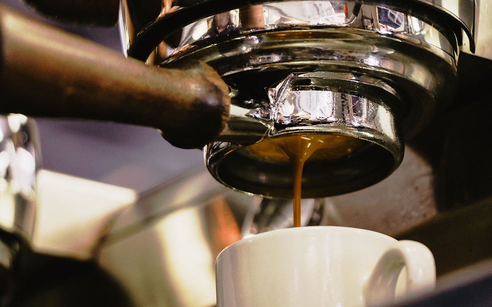 espresso being extracted from a coffee machine