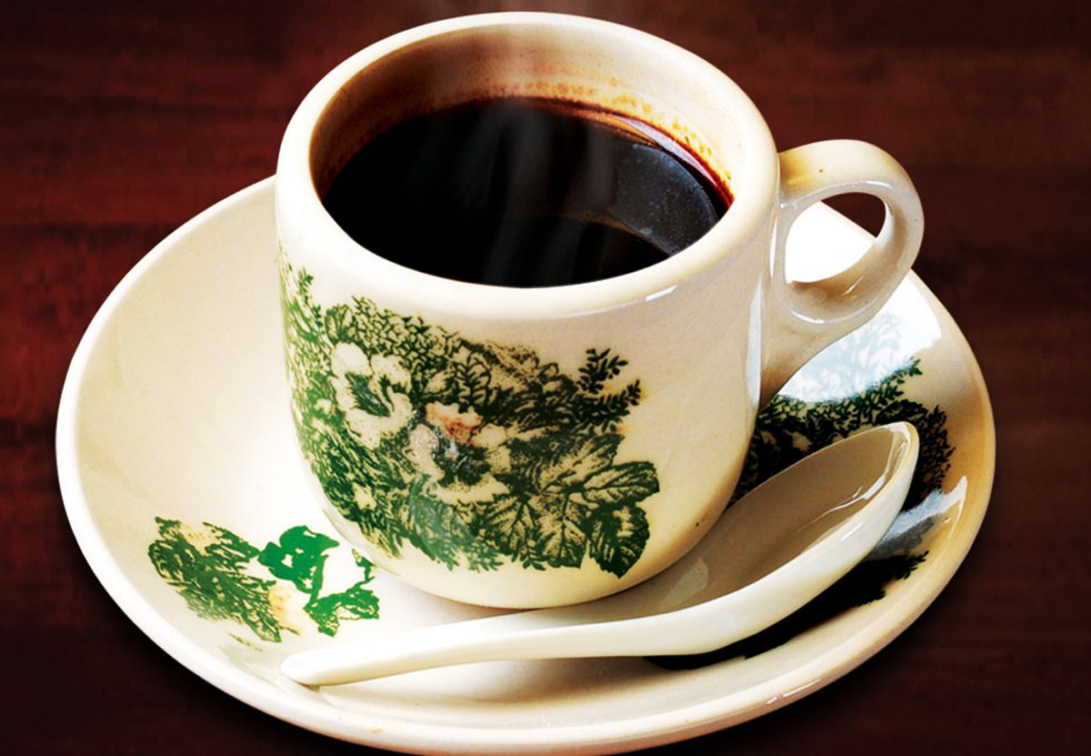 black coffee in an antique cup
