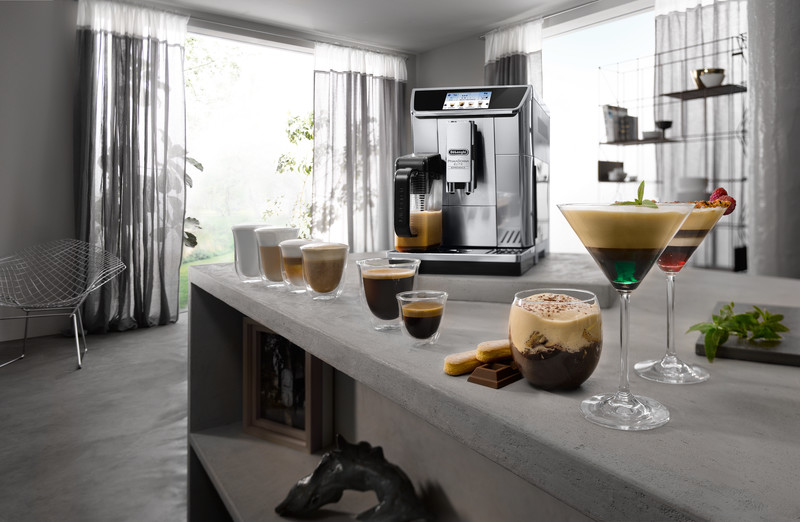 The De'Longhi Prima Donna Elite coffee machine with a variety of coffee drinks surrounding it