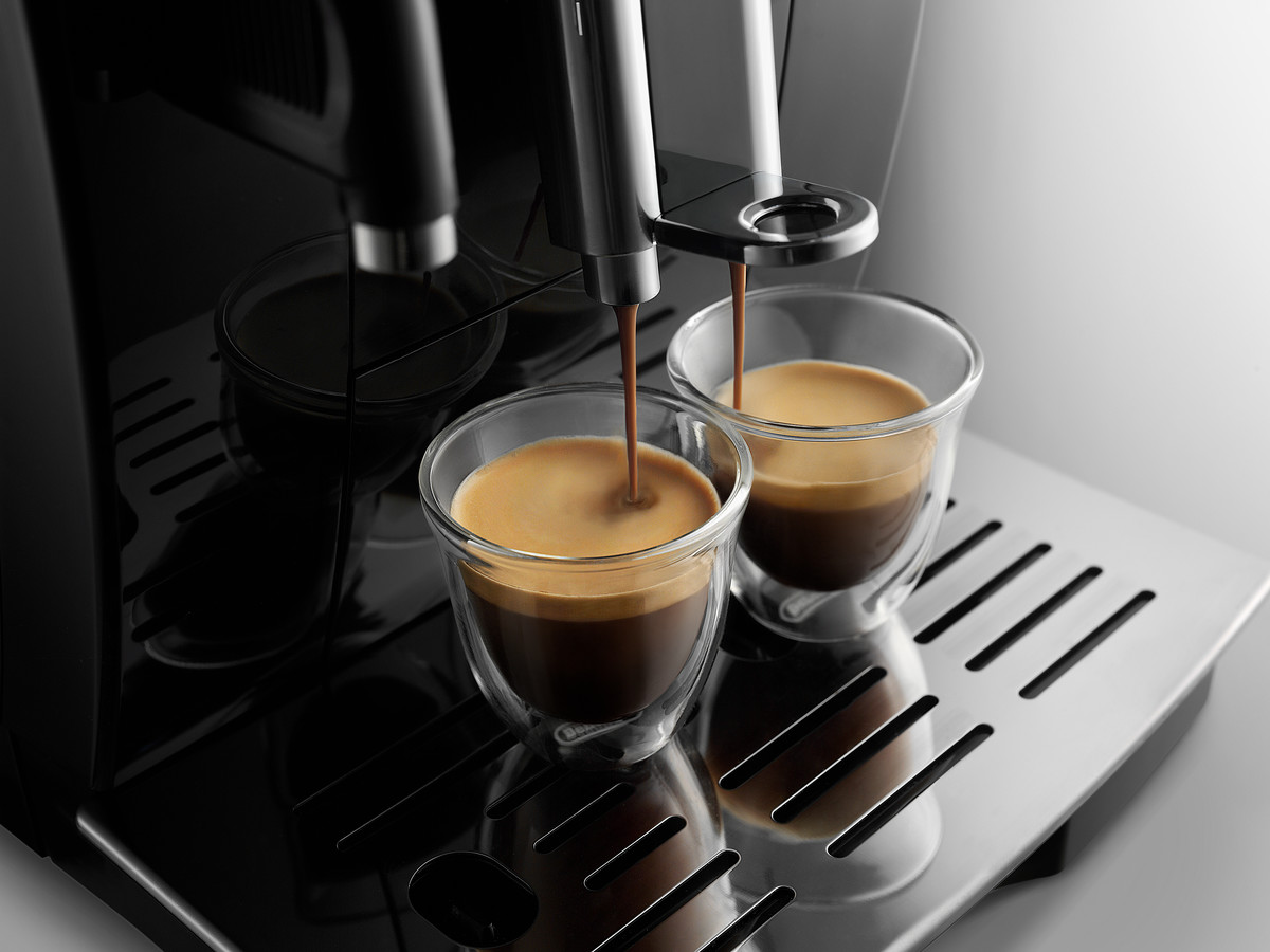 a coffee machine dispensing coffee into two cups
