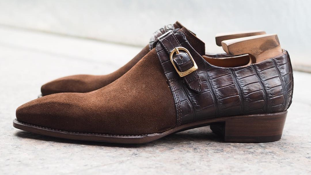 a brown pair of shoes with suede material
