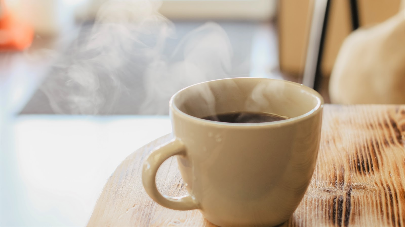 a hot cup of coffee with steam