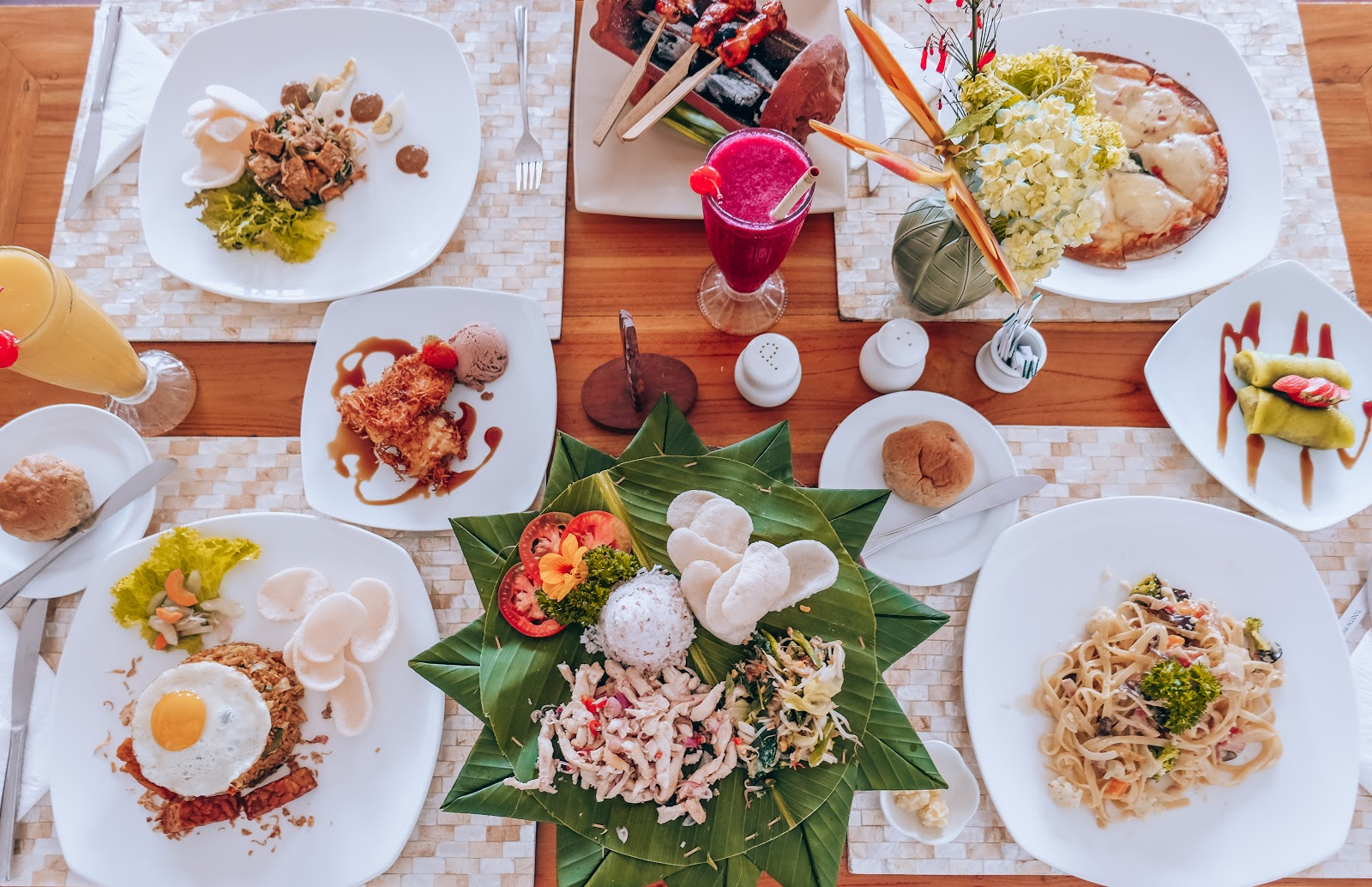a table filled with Indonesian cuisine dishes