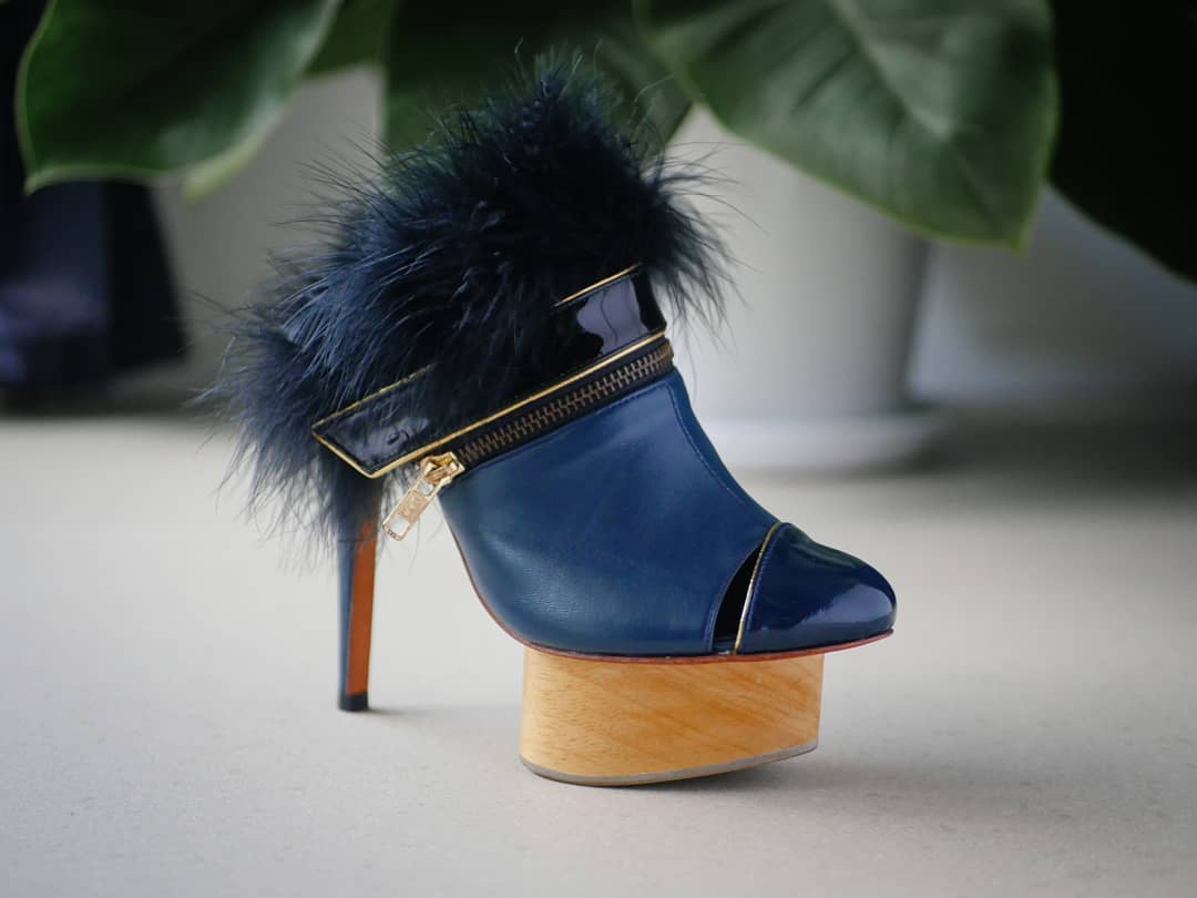 a blue high heels shoe
