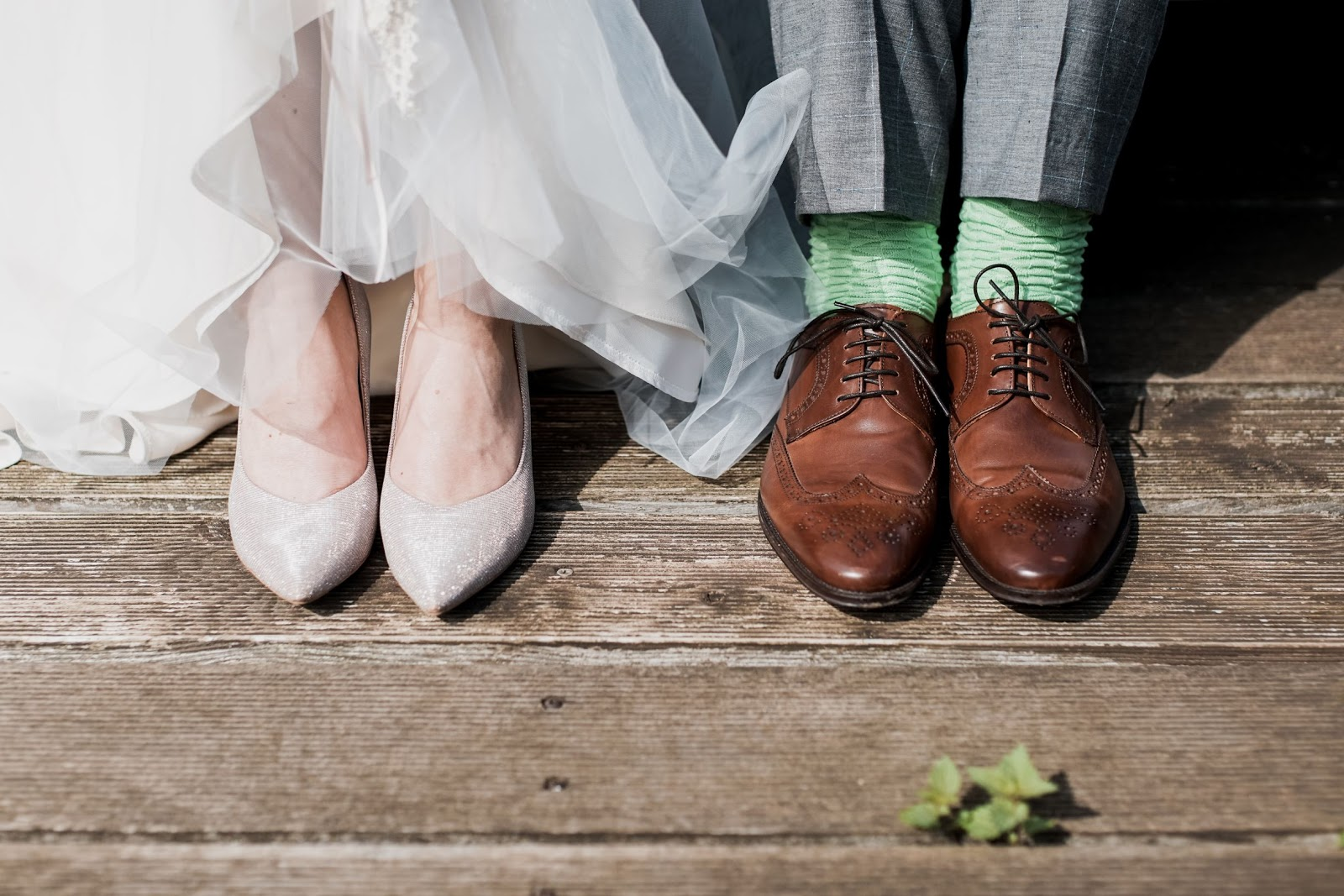 a closeup shot of a couple wearing heels and shoes