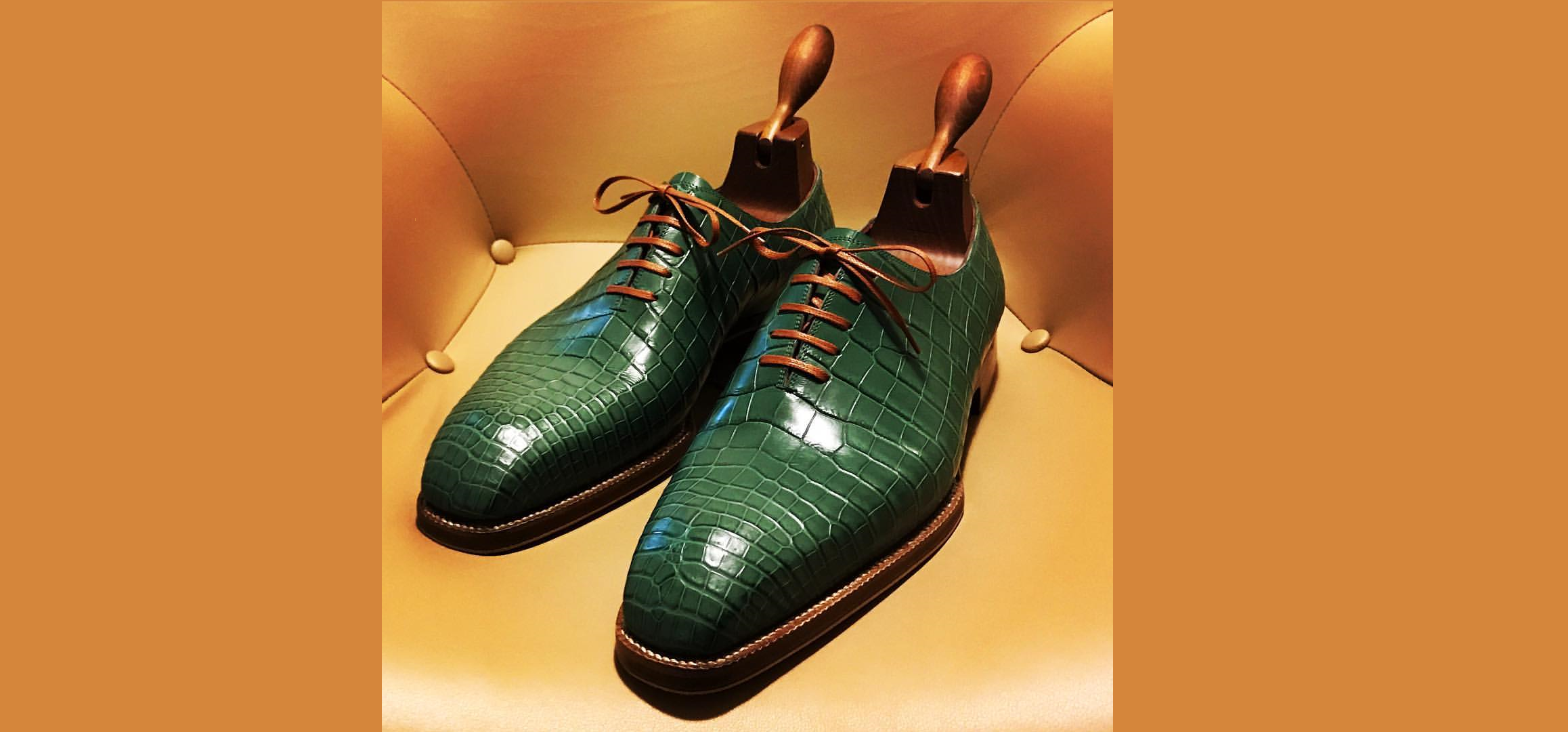 A pair of emerald green leather oxfords by Josh Leong