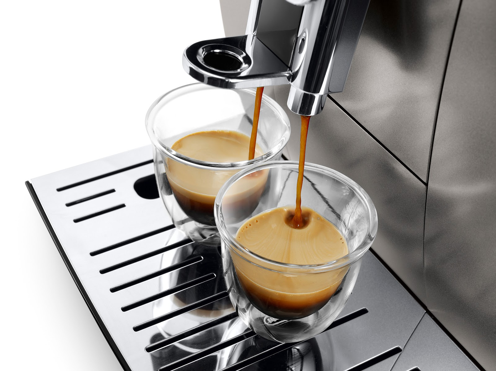 a coffee machine dispensing two cup of coffee