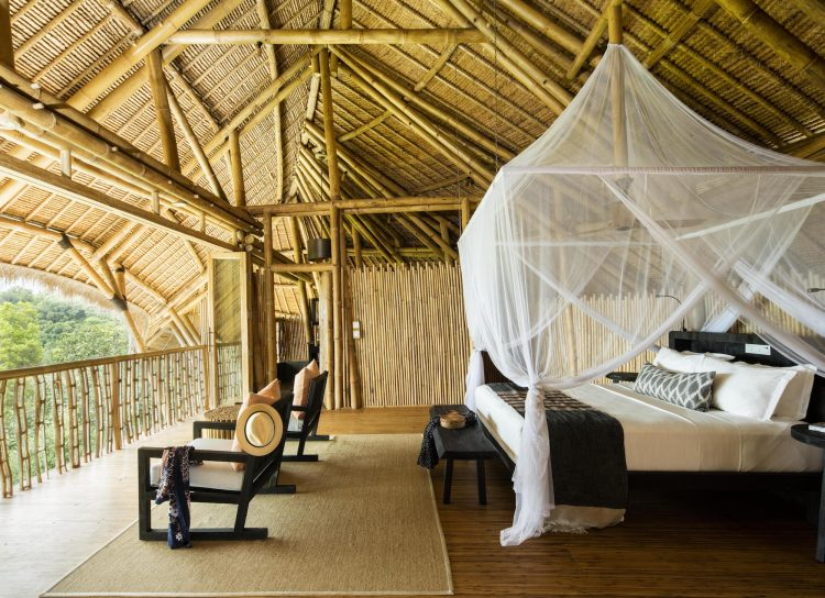 a resort villa bedroom made from bamboo stilts