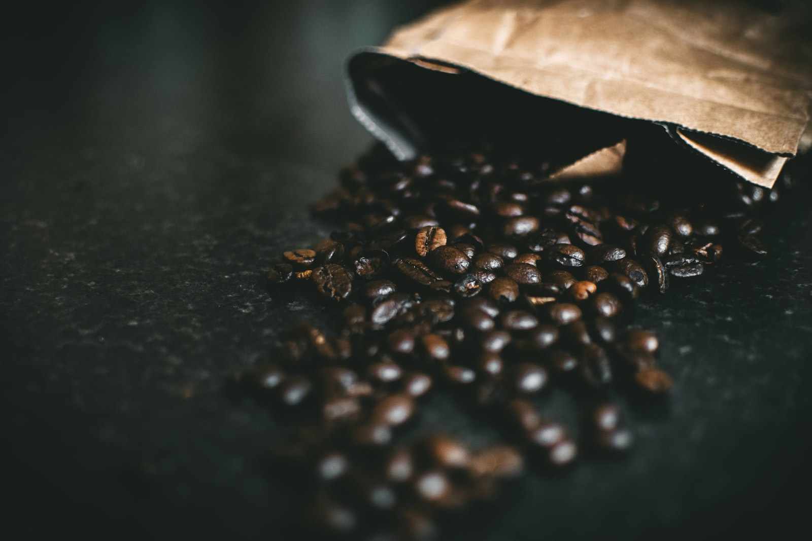 coffee beans spilling out of a paper bag