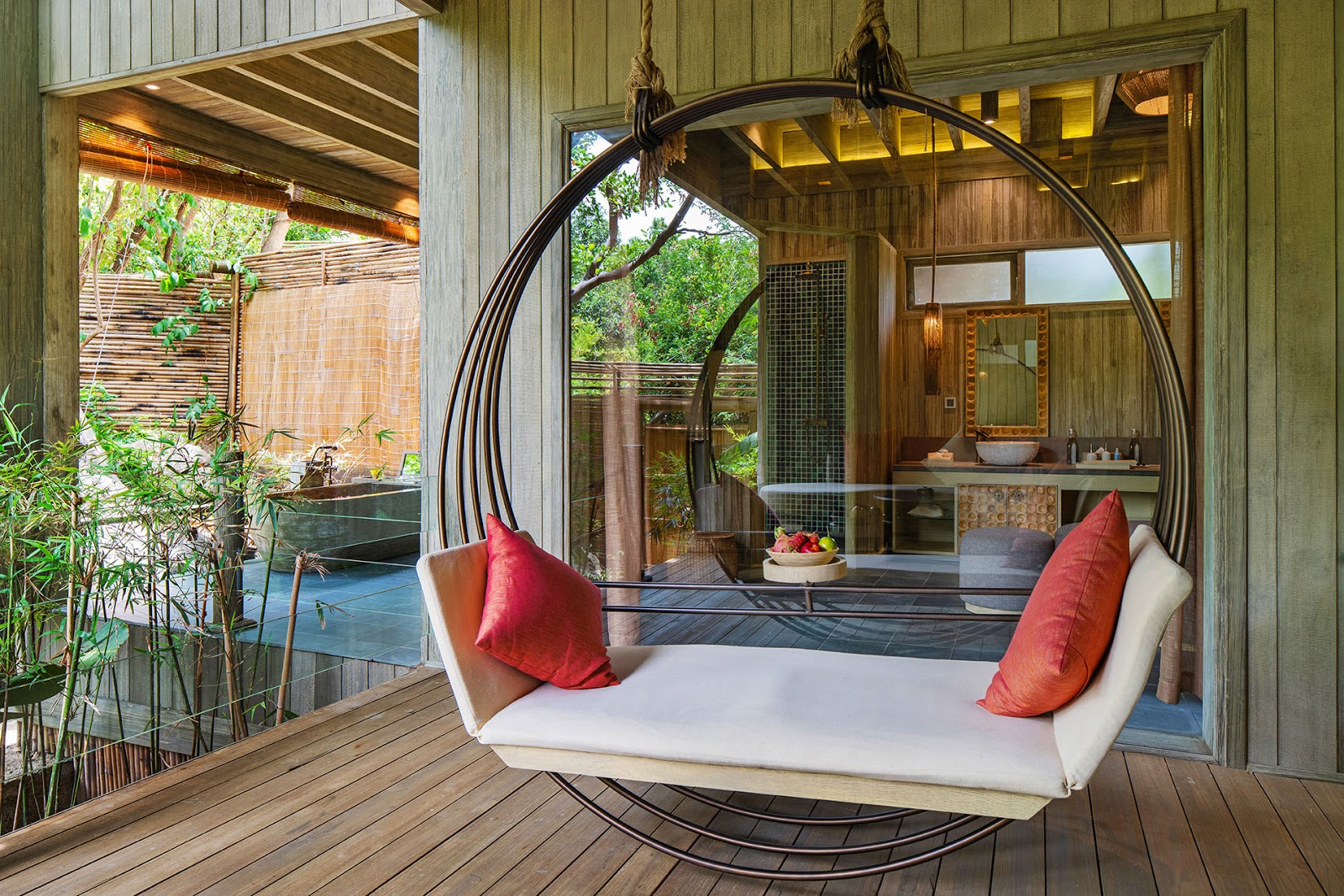 a resort bedroom made from wooden finishes