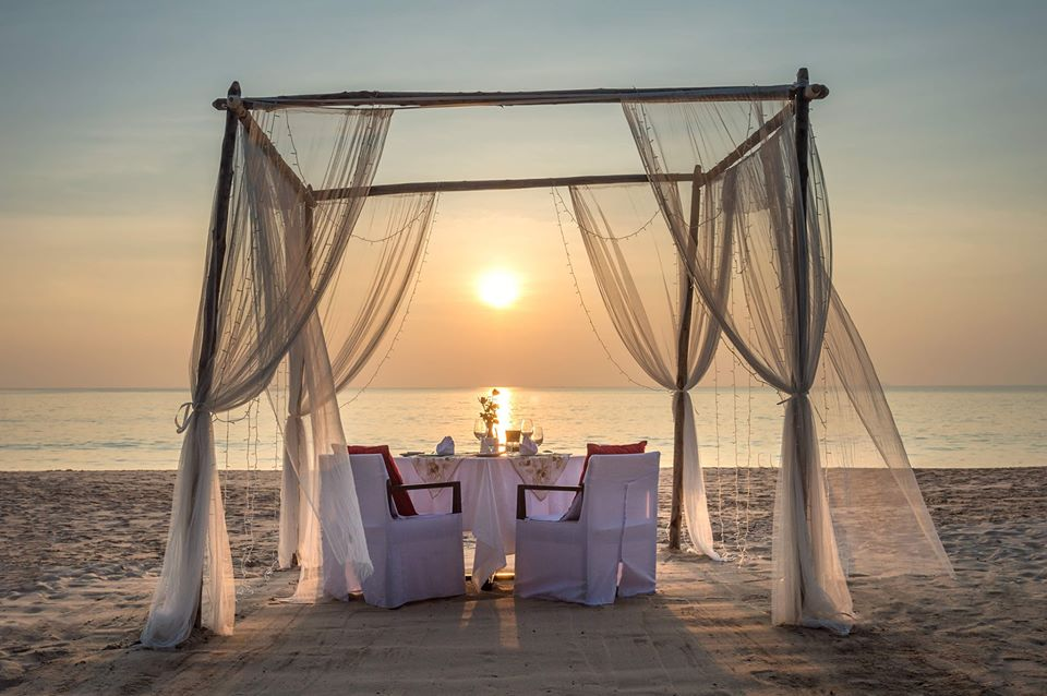 a private pergola dinner on a beach