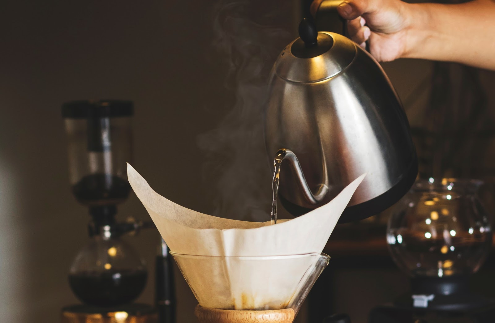 pouring hot water into a coffee filter of a chemex