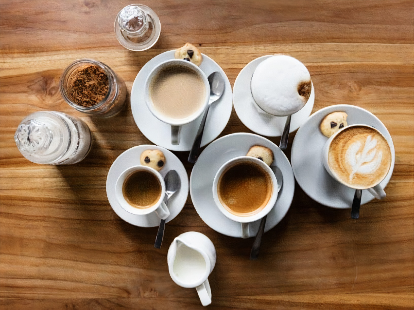 cups of various coffee beverages placed side by side