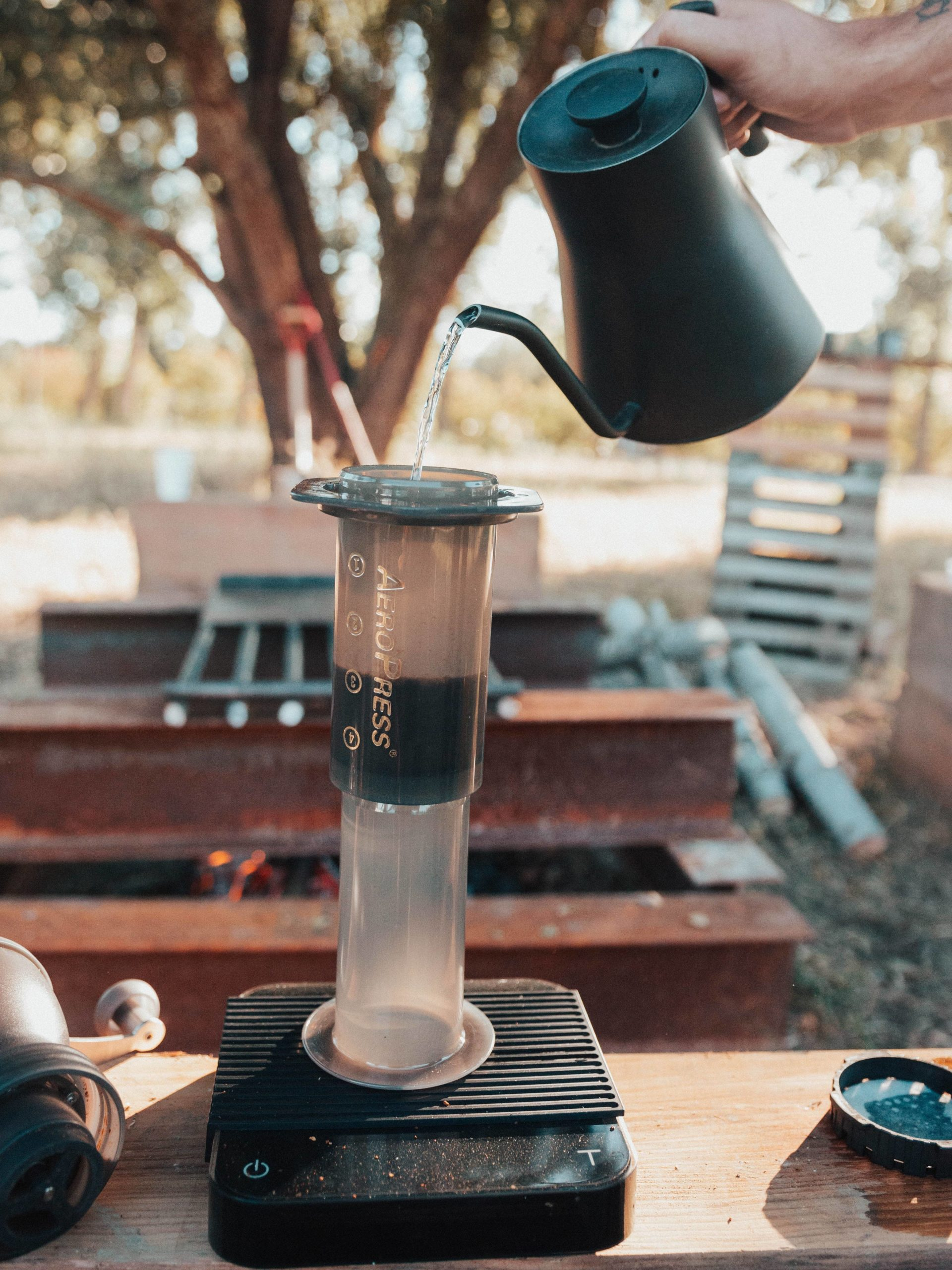 Pouring water from a kettle into an Aeropress