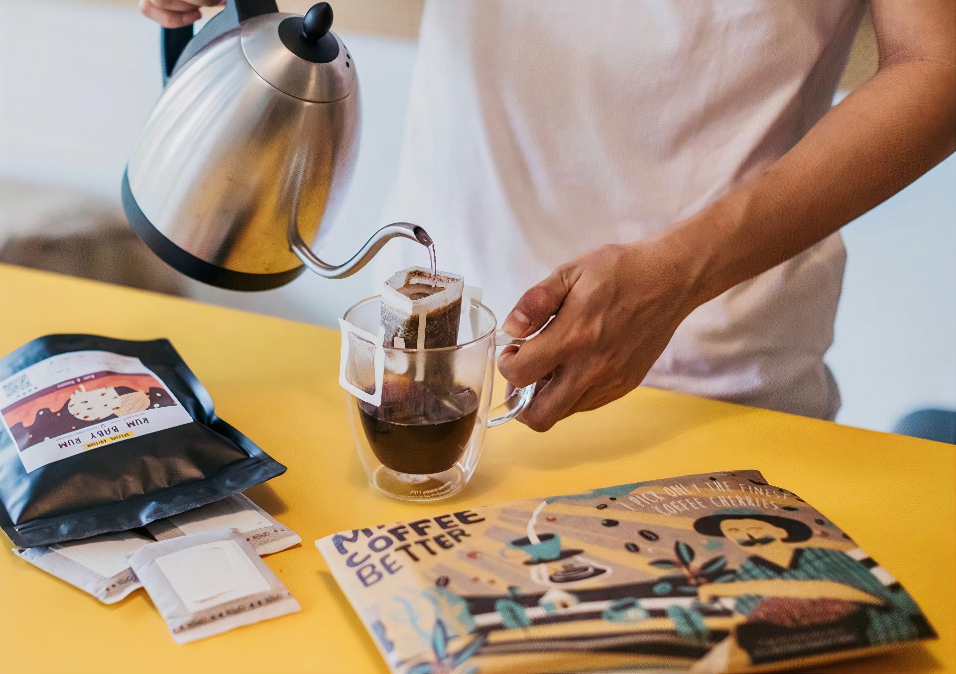 a man pouring water into a drip coffee bag