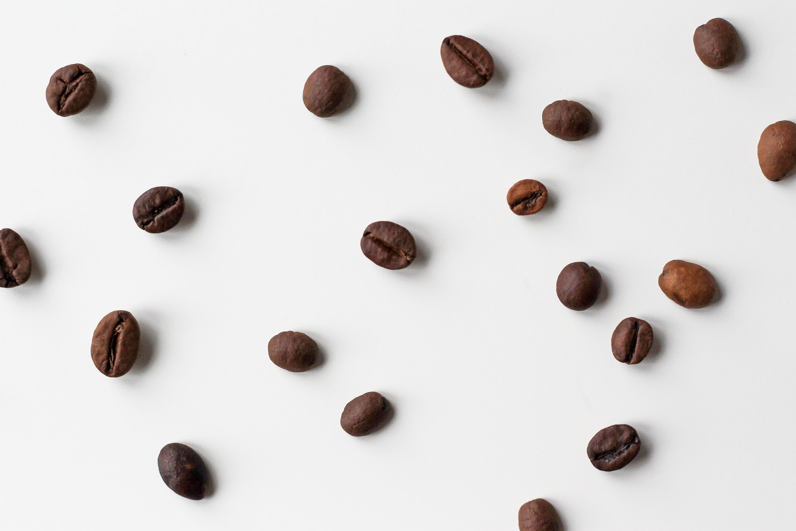 coffee beans scattered on a white background
