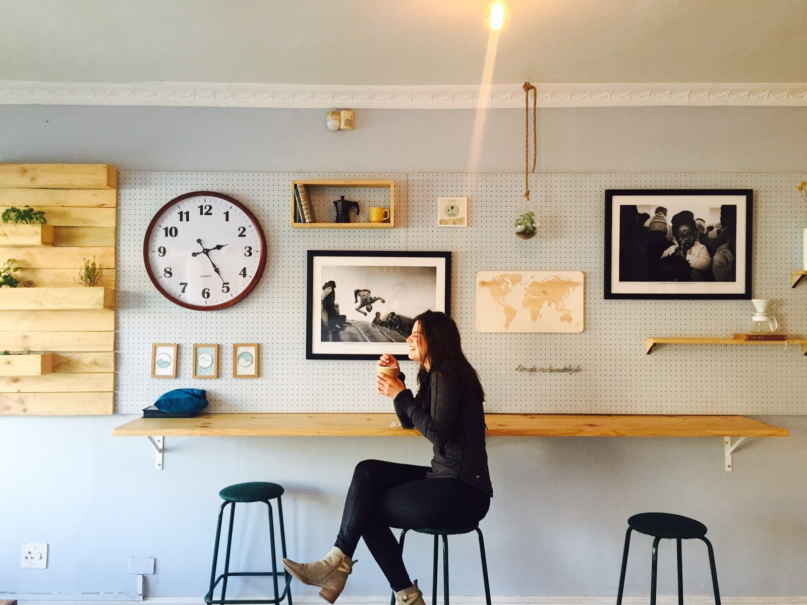 woman sipping on coffee at a cafe