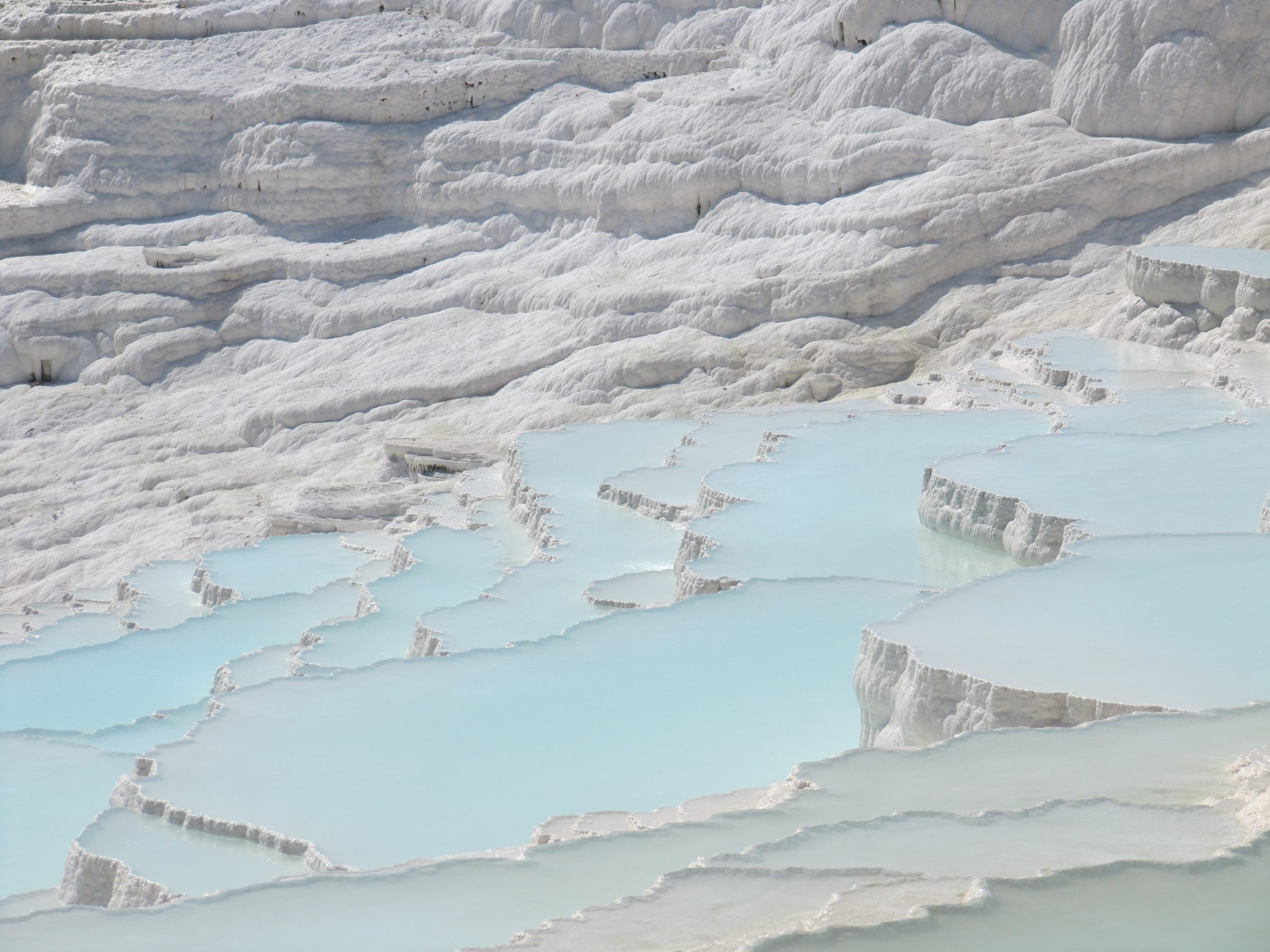 Pamukkale's cotton-white terraces filled with powder blue waters