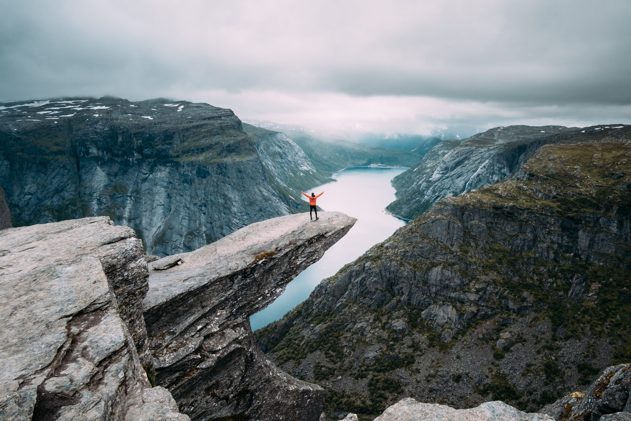 a man standing on the edge of a cliff