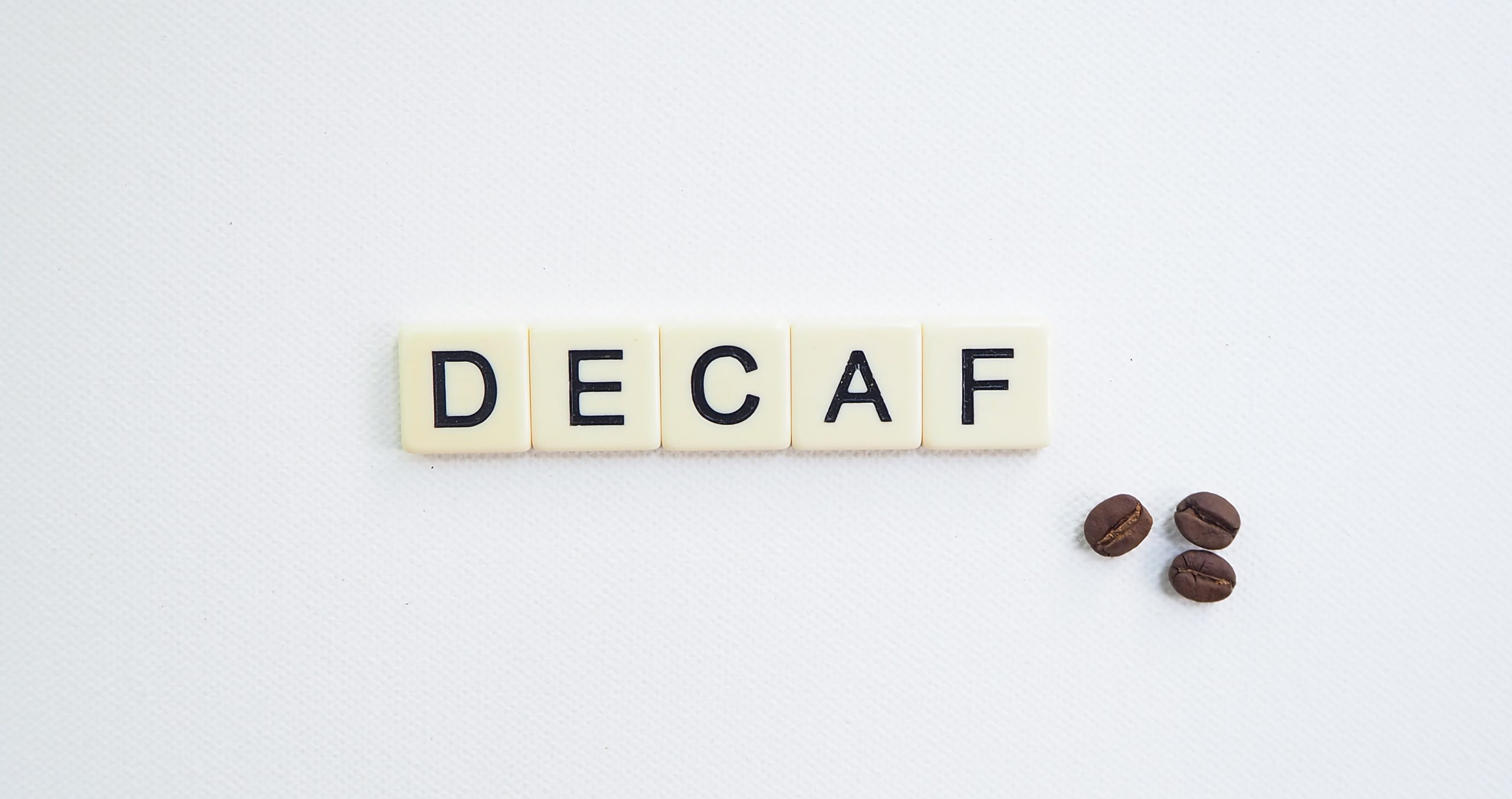alphabets and coffee beans on table