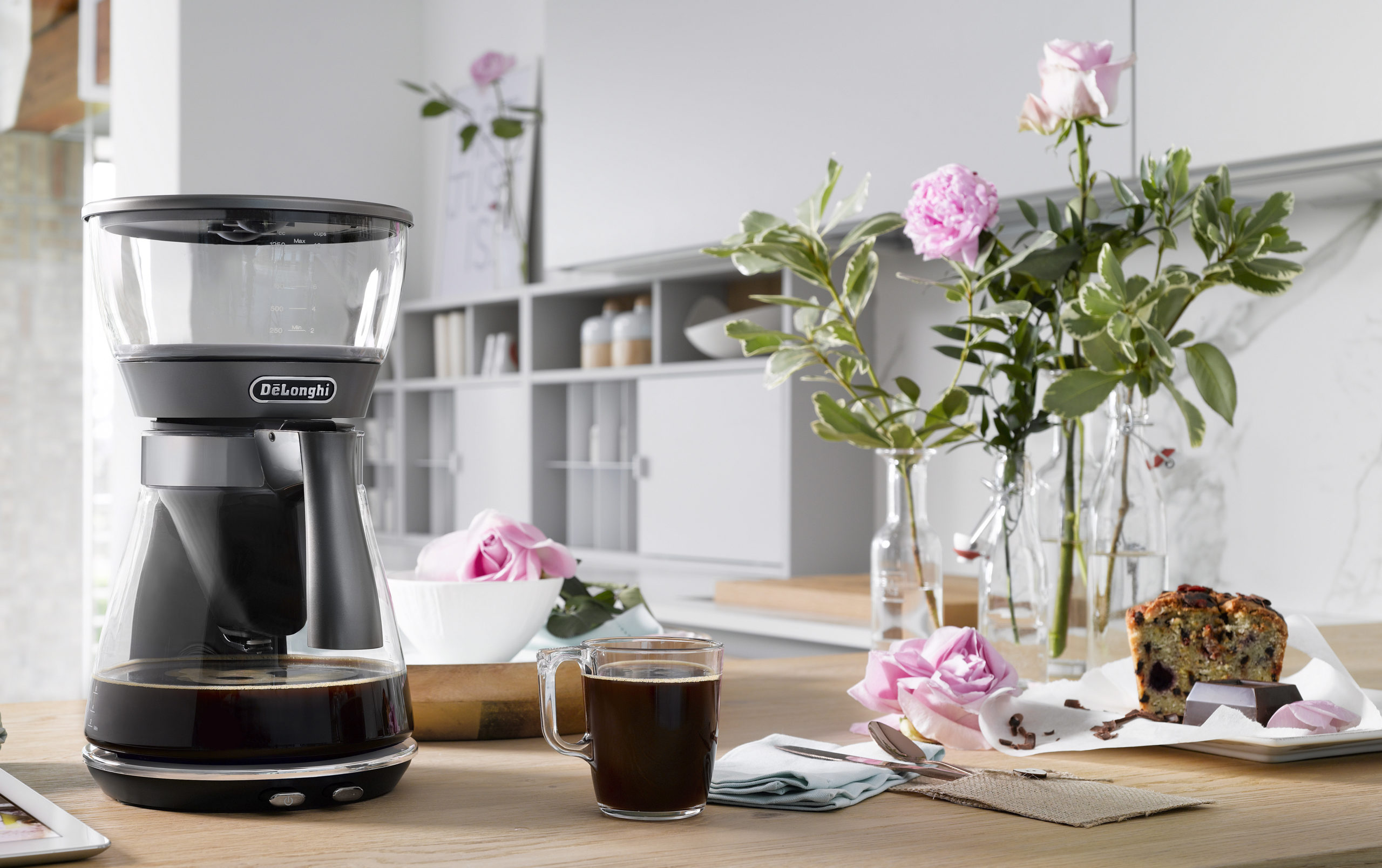 De'Longhi coffee drip machine placed on a table