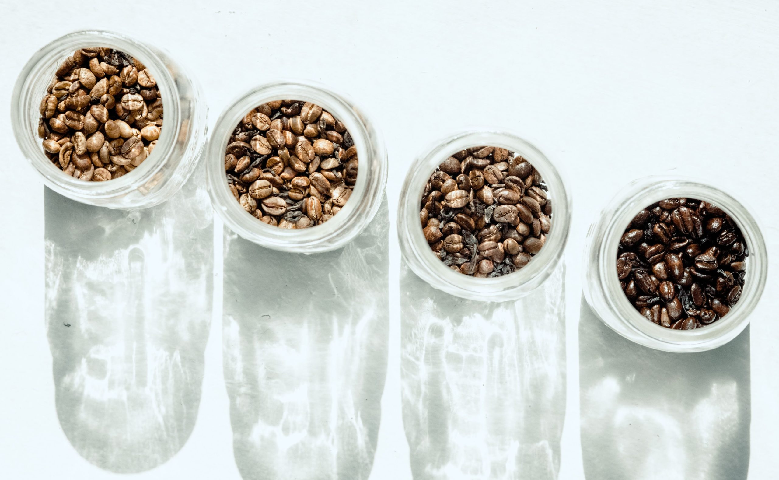4 jars filled with coffee beans